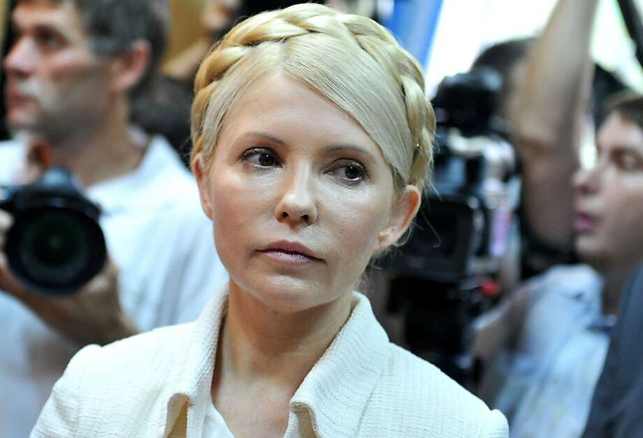 (FILES) In this photograph taken on June 24, 2011 Ukraine's ex-prime minister Yulia Tymoshenko looks on at the beginning her court hearing in Kiev. Ukraine's jailed opposition leader Yulia Tymoshenko began receiving back pain treatment in hospital on April 21, 2012 after missing the controversial opening of her new trial for tax fraud. AFP PHOTO/ SERGEI SUPINSKY (Photo credit should read SERGEI SUPINSKY/AFP/Getty Images) Photo: Sergei Supinsky, AFP/Getty Images