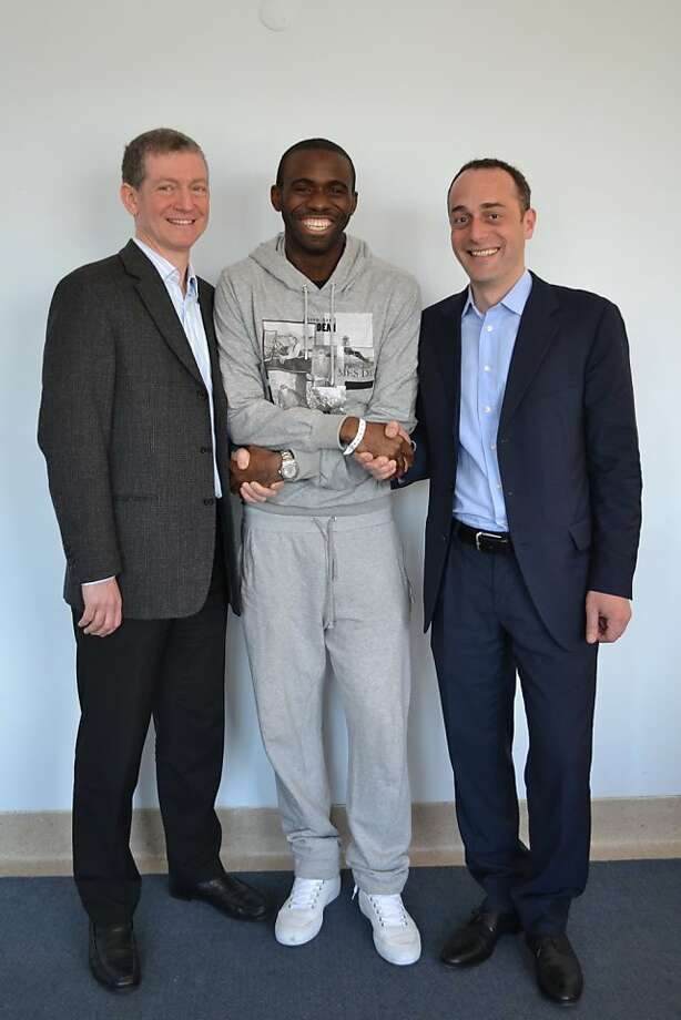 This photo made available by Barts Health NHS (National Health Service) Trust shows Dr Andrew Deaner, left, Bolton midfield soccer player, Fabrice Muamba, and Dr Sam Mohiddin, the senior cardiologist who has been in charge of Fabrice's care throughout his time at the hospital, as the Bolton Wanderers footballer was discharged from hospital Monday, April 16, 2012. Dr. Deaner was the doctor who rushed onto the pitch at White Heart Lane when Fabrice Muamba first collapsed in the FA Cup tie. Fabrice Muamba was discharged Monday from the hospital where the Bolton midfielder had been treated since collapsing from a cardiac arrest during a game less than a month ago. The former England under-21 international had been in the London Chest Hospital, part of the Trust, since collapsing on March 17. His heart stopped beating on its own for 78 minutes while doctors worked to resuscitate him and his prospects of survival were uncertain. But Muamba recovered remarkably quickly _ leaving his bed just nine days after collapsing. Photo: Associated Press