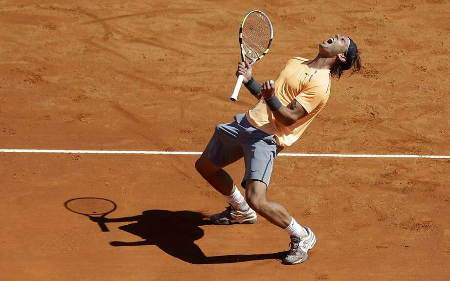 CORRECTS OPPONENT - Rafael Nadal of Spain reacts after defeating Novak Djokovic of Serbia in their final match of the Monte Carlo Tennis Masters tournament in Monaco, Sunday, April 22, 2012. (AP Photo/Lionel Cironneau) Photo: Lionel Cironneau, Associated Press