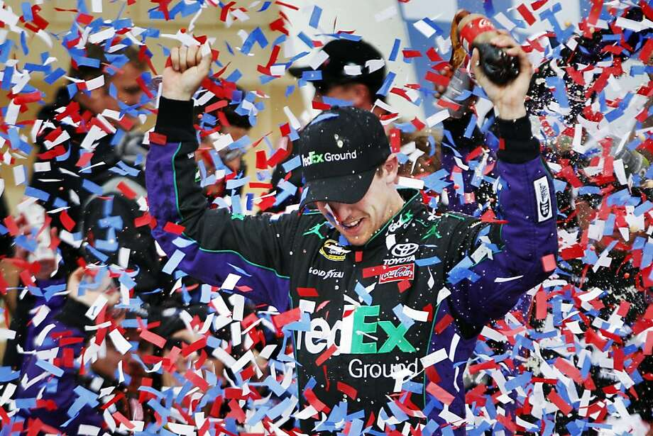 Denny Hamlin celebrates in victory lane after winning the NASCAR Sprint Cup Series auto race at Kansas Speedway in Kansas City, Kan., Sunday, April 22, 2012. (AP Photo/Orlin Wagner) Photo: Orlin Wagner, Associated Press