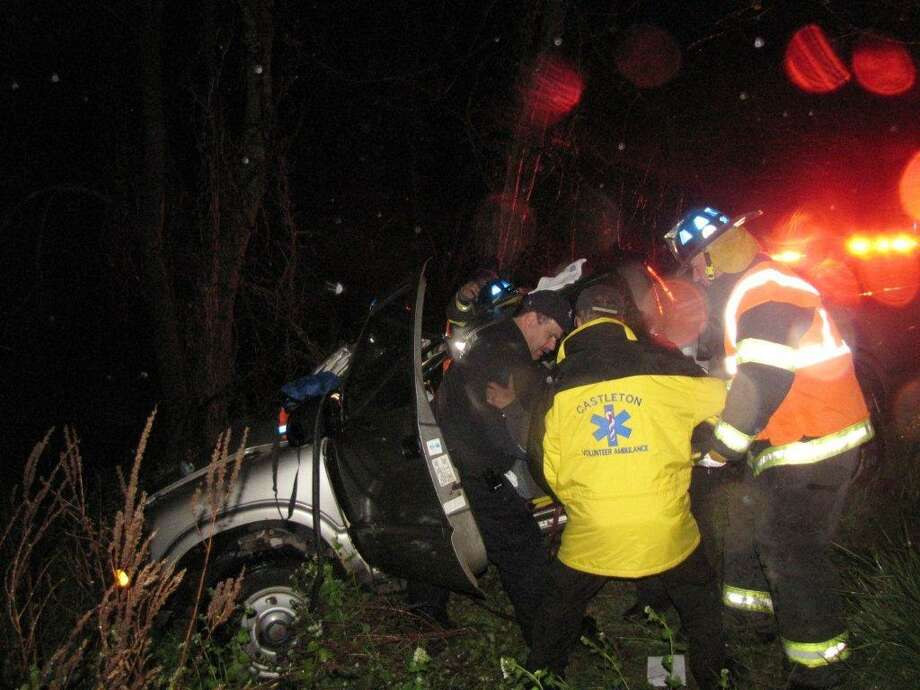 Rescue crews pull a woman from a truck after a one-vehicle crash early Monday morning in Schodack. (Marty Miller / Special to the Times Union)