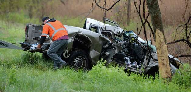 A pickup truck involved in a fatal crash sits at the base of a tree Monday morning near Route 9J in Schodack. (Skip Dickstein / Times Union) Photo: SKIP DICKSTEIN / 2012
