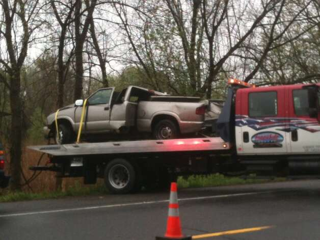 A pickup truck involved in fatal accident early Monday morning is towed from the scene. (Bryan Fitzgerald / Times Union)
