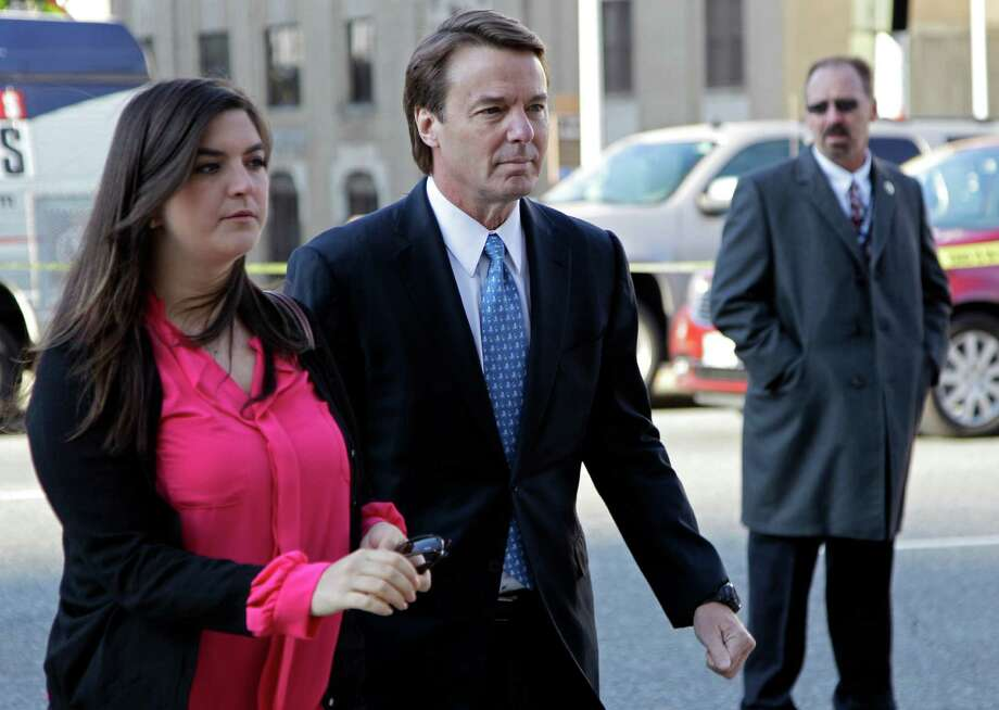 Former presidential candidate and U.S. Sen. John Edwards, center, arrives outside federal court with his daughter Cate, left, in Greensboro, N.C., for his trial on charges of violating federal campaign finance laws, Monday, April 23, 2012. Opening statements were to begin Monday. Edwards, 58, pleaded not guilty to six criminal counts related to nearly $1 million in secret payments from two wealthy supporters. Much of the money was used to hide the then-married politician's pregnant mistress during his 2008 White House campaign.   (AP Photo/Chuck Burton) Photo: Chuck Burton, STF / AP