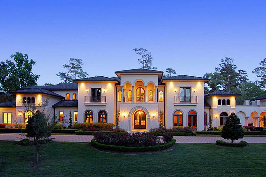 A look at the front exterior of the property, spotlighting the professional landscaping as well as the architecture of the home. Photo: Realtor.com