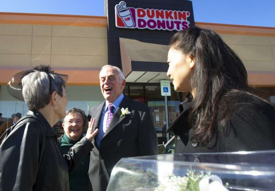 Houstonians Nancy Christian and Clark Bennett got married at a Dunkin Donuts in Bellaire in 2011. (Cody Duty / Houston Chronicle)