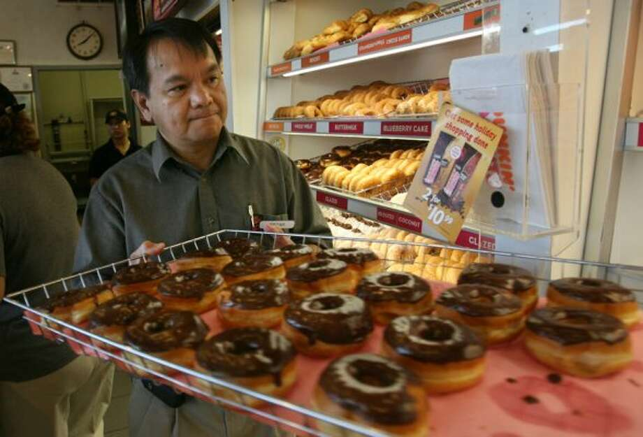 Edgar Timtiman is pictured at the Dunkin Donuts at 320 S. Wayside Dr. in Houston in 2006. (Mayra Beltran / Houston Chronicle)