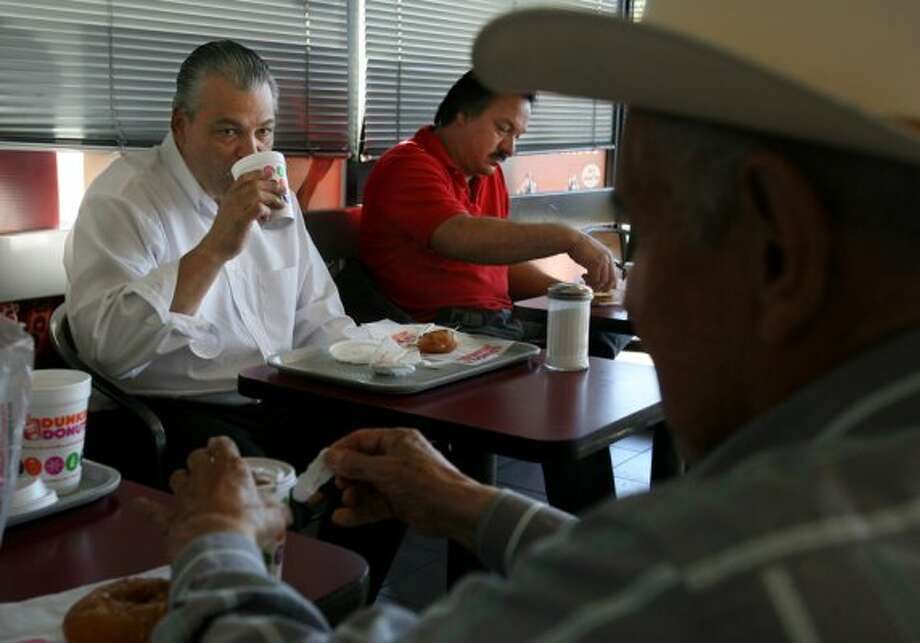 Houston customers dine at the Dunkin Donuts at 320 S. Wayside Dr. in Houston in 2006. (Mayra Beltran / Houston Chronicle)