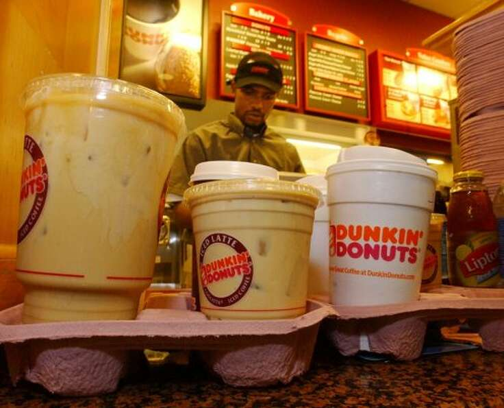 Dunkin Donuts is known also for its coffee brew and expanding selection of specialty drinks. (AP)