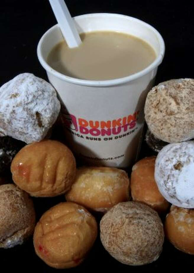 Dunkin Donuts is known also for its coffee brew and expanding selection of specialty drinks. (Toby Talbot / Associated Press)