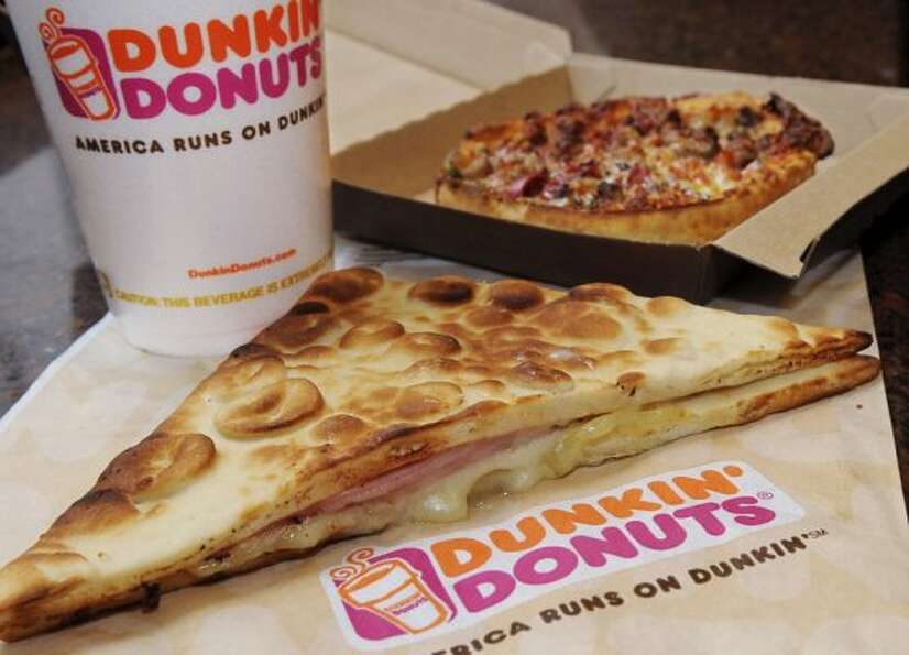 Dunkin also offers savory treats like a flatbread sandwich and personal pizza. (Lisa Poole / AP)