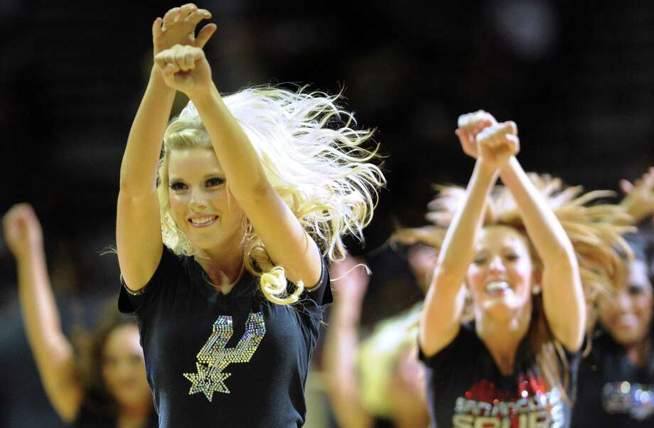 The Spurs Silver Dancers perform during a timeout at the AT&T Center on Saturday, April 14, 2012. Billy Calzada / San Antonio Express-News Photo: BILLY CALZADA, San Antonio Express-News / SAN ANTONIO EXPRESS-NEWS