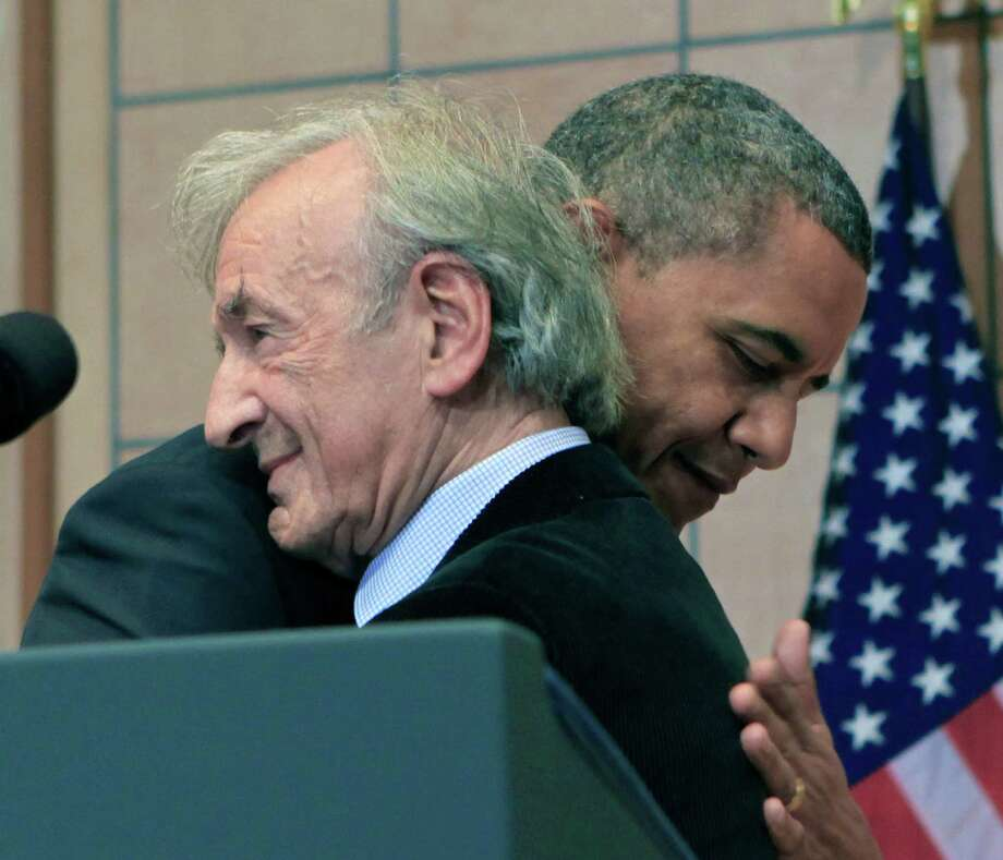 U.S. President Barack Obama (R) hugs Elie Wiesel before a speech at the Holocaust Museum in the Hall of Remembrance at the Holocaust Museum April 23, 2012 in Washington, DC. Obama reportedly announced a new sanctions March 23, on Iran and Syria for entities and people using technology to target citizens. Photo: Pool, Getty Images / 2012 Getty Images