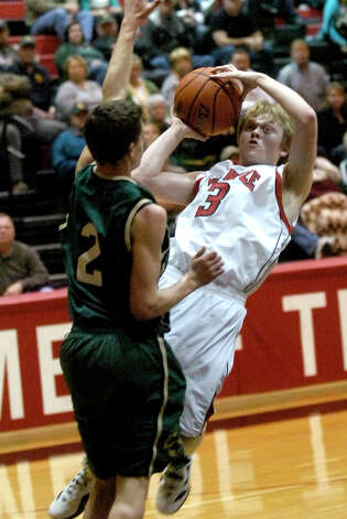 Kountze's Laramie Linn is fouled by East Chambers' Hayden Touchet at Kountze High School in Kountze, Friday, January 27, 2012. Tammy McKinley/The Enterprise Photo: TAMMY MCKINLEY