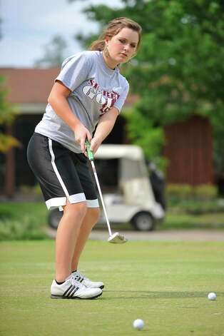 Silsbee freshman golfer Allison Davis works on the putting green during a practice session at the Silsbee Country Club. Davis is heading to the state golf tournament in May.  Tuesday, April 26, 2011.  Valentino Mauricio/The Enterprise Photo: Valentino Mauricio / Beaumont