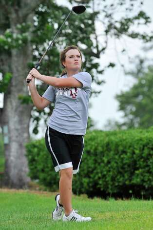Silsbee freshman golfer Allison Davis follows through on a drive shot during a practice session at the Silsbee Country Club. Davis is heading to the state golf tournament in May.  Tuesday, April 26, 2011.  Valentino Mauricio/The Enterprise Photo: Valentino Mauricio / Beaumont