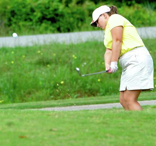 Little Cypress-Mauriceville golfer Brooke Brasseaux hits her ball out of the rough towards the hole Thursday April 4, 2012, at the Bayou Din golf course in Beaumont Texas. The District 20-4A golf tournament was Wednesday and Thursday at the course. Dave Ryan/The Enterprise Photo: Dave Ryan / BMTENT