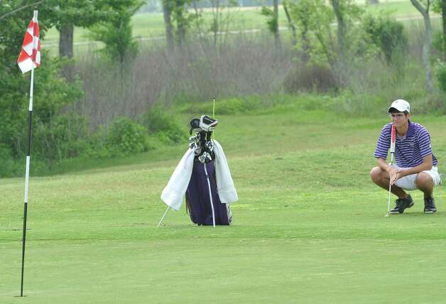 Port Neches-Groves golfer Lonnie LaBove sizes up the first hole Thursday April 4, 2012, at the Bayou Din golf course in Beaumont Texas. The District 20-4A golf tournament was Wednesday and Thursday at the course. Dave Ryan/The Enterprise Photo: Dave Ryan / BMTENT