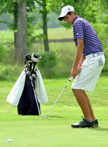 Port Neches-Groves golfer Lonnie LaBove watches his ball roll around the lip of the the first hole Thursday April 4, 2012, at the Bayou Din golf course in Beaumont Texas. The District 20-4A golf tournament was Wednesday and Thursday at the course. Dave Ryan/The Enterprise Photo: Dave Ryan / BMTENT