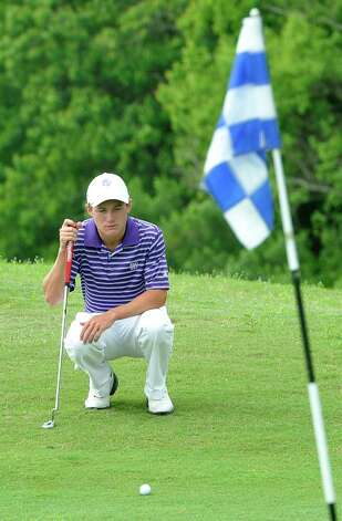 Port Neches-Groves golfer Brandon Provost  sizes up the slope to the hole Thursday April 4, 2012, at the Bayou Din golf course in Beaumont Texas. The District 20-4A golf tournament was Wednesday and Thursday at the course. Dave Ryan/The Enterprise Photo: Dave Ryan / BMTENT