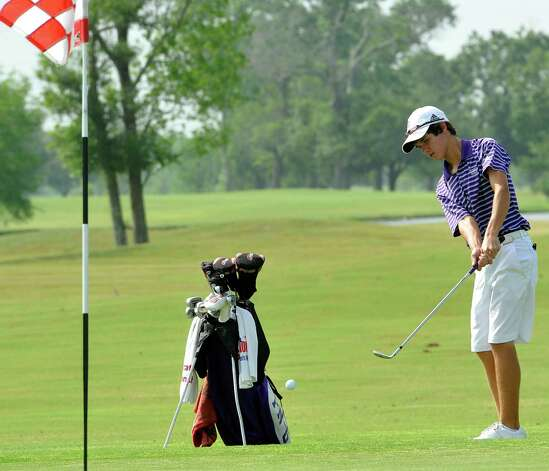 Port Neches-Groves golfer Braden Bailey chips his ball towards the hole Thursday April 4, 2012, at the Bayou Din golf course in Beaumont Texas. The District 20-4A golf tournament was Wednesday and Thursday at the course. Dave Ryan/The Enterprise Photo: Dave Ryan / BMTENT