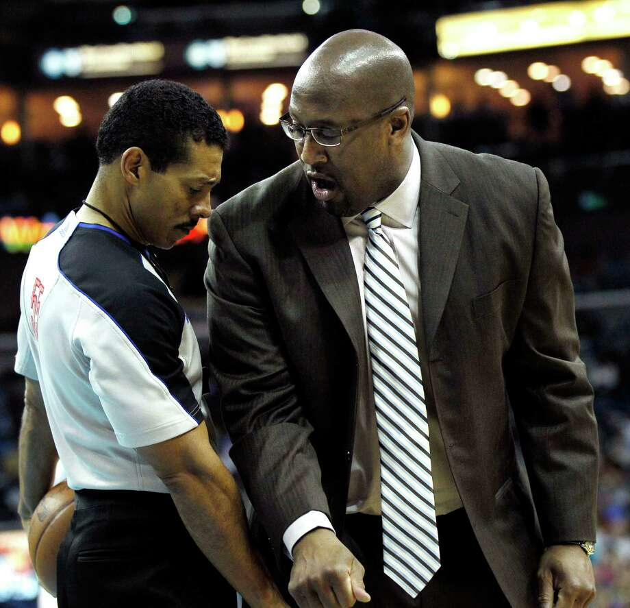A reader verbally jabs Los Angeles Lakers coach Mike Brown for keeping starters in a hopeless game. Photo: Gerald Herbert, Associated Press