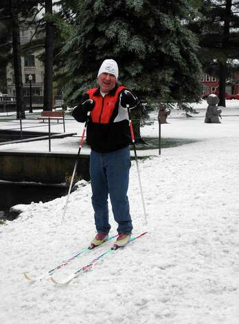 John Dimon poses for a photo on his skis near Riverside Park in Saranac Lake, N.Y., Monday.  A spring nor'easter packing soaking rain and high winds churned up the Northeast Monday morning, unleashing a burst of winter and up to a foot of snow in higher elevations inland, closing some schools and sparking concerns of power outages. Photo: AP