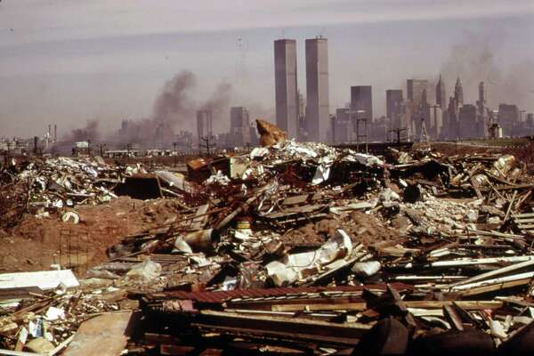 "This March 1973 photo released by the U.S. National Archives shows an illegal dumping area off the New Jersey Turnpike, facing Manhattan across the Hudson River, and north of the land fill area of the proposed Proposed Liberty State Park, N.J. This archival image was taken for the ""Documerica"" program, begun in 1972 by the new Environmental Protection Agency, to document subjects of environmental concern. (AP Photo/U.S. National Archives, Gary Miller)"