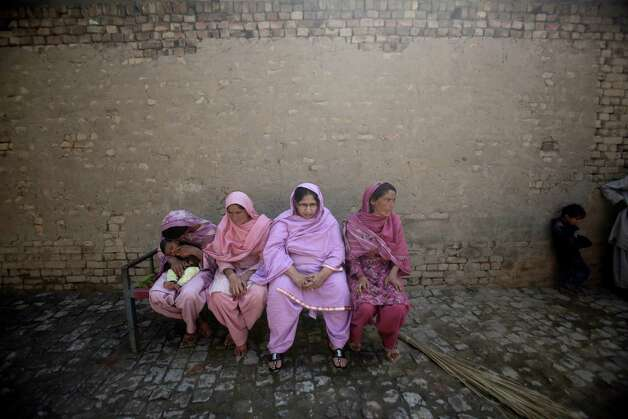 Pakistani women on Monday sit on a bed next to the wreckage of a Bhoja Air Boeing 737 passenger plane, not pictured, that crashed on Friday, killing all 127 people on board, on the outskirts of Islamabad, Pakistan. The Pakistani government mandated Sunday that all airplanes operated by private airlines must undergo a new inspection to determine whether they are safe to fly, days after a crash near the capital killed 127 people. The Bhoja Air crash Friday was the second in Pakistan in less than two years involving a private Pakistani airline. In both cases, the planes went down in bad weather as they approached the main airport in Islamabad. (AP Photo/Nathalie Bardou) Photo: Nathalie Bardou, ASSOCIATED PRESS / AP2012