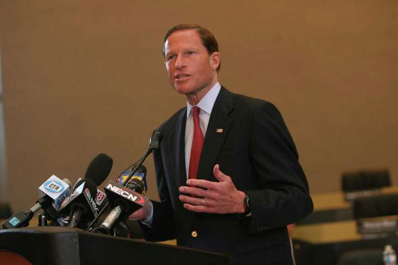 Senator Richard Blumenthal speaks during a ceremony in Bridgeport City Hall to honor the victims and