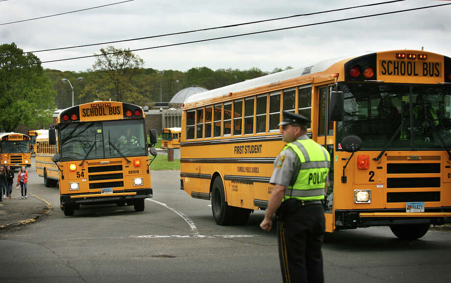 First Student buses exit Hillcrest Middle School in Trumbull on Monday, April 23, 2012. Photo: Brian A. Pounds / Connecticut Post