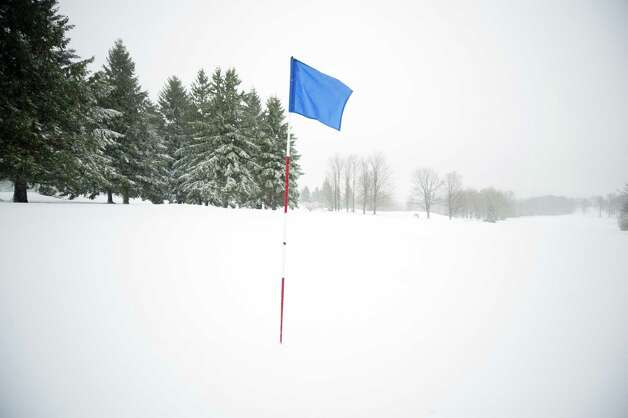 The 18th hole at the Seven Springs Golf Course sits under a blanket of snow Monday in Somerset, Pa. Photo: Jeff Swensen, Getty Images / 2012 Getty Images
