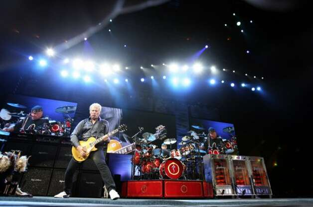 Rush appears at Verizon Guitar Alez Lifeson, Bass Geddy Lee, Drums Neil Peart August 12, 2007.  (San Antonio Express-News)