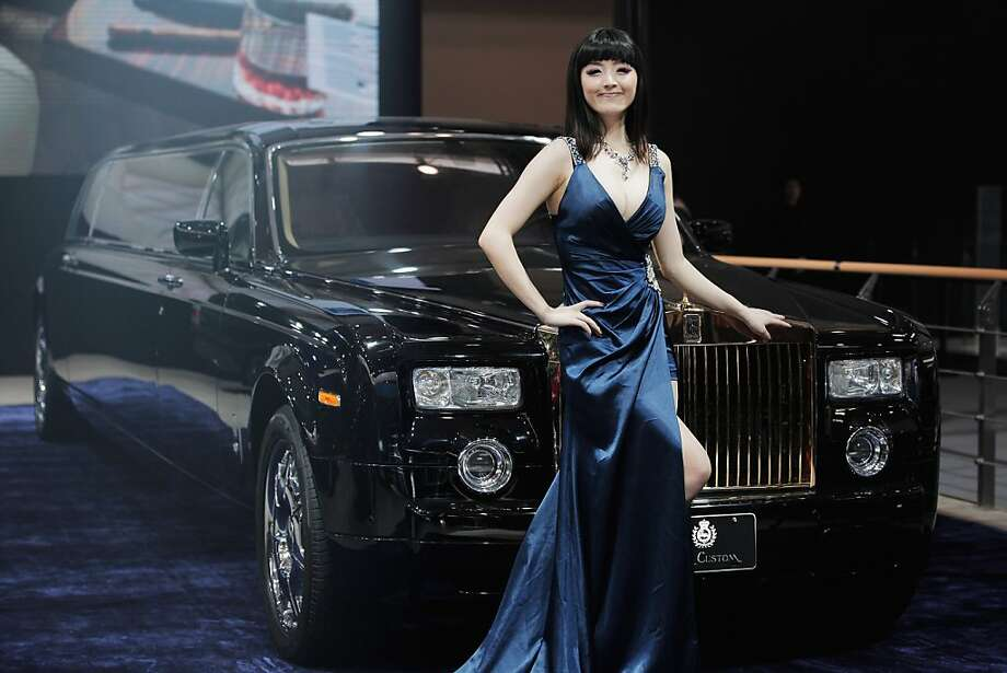 BEIJING, CHINA - APRIL 23: A model stands beside a Rolls-Royce Star Custom during the media day of the 2012 Beijing International Automotive Exhibition at beijng International Exhibition Center on April 23, 2012 in Beijing, China.  Auto China is China's leading auto show and many of the world's carmakers are in attendance despite lagging sales in the country.  (Photo by Lintao Zhang/Getty Images) Photo: Lintao Zhang, Getty Images