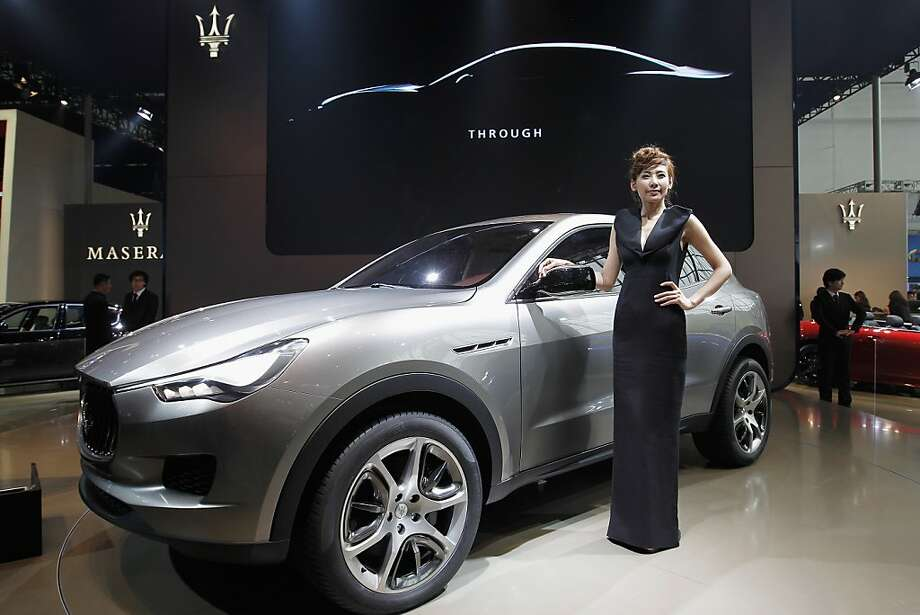 BEIJING, CHINA - APRIL 23:  A model stands beside a Maserati kubang car during the media day of the 2012 Beijing International Automotive Exhibition at beijng International Exhibition Center on April 23, 2012 in Beijing, China.  Auto China is China's leading auto show and many of the world's carmakers are in attendance despite lagging sales in the country.  (Photo by Lintao Zhang/Getty Images) Photo: Lintao Zhang, Getty Images