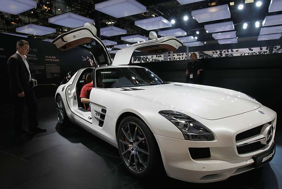 BEIJING, CHINA - APRIL 23: Visitors look at a Mercedes SLS AMG car is displayed during the media day of the 2012 Beijing International Automotive Exhibition at beijng International Exhibition Center on April 23, 2012 in Beijing, China. Auto China is China's leading auto show and many of the world's carmakers are in attendance despite lagging sales in the country.  (Photo by Lintao Zhang/Getty Images) Photo: Lintao Zhang, Getty Images