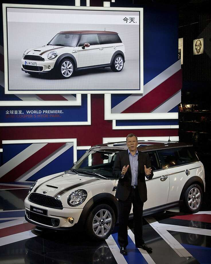 Mini Senior Vice President Kay Segler speaks in front of a Mini Cooper S Hyde Park car after it was unveiled at the Beijing International Automotive Exhibition in Beijing, China, Monday, April 23, 2012. (AP Photo/Andy Wong) Photo: Andy Wong, Associated Press