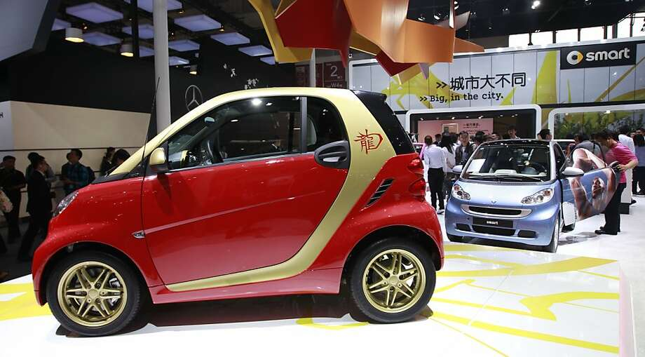 A Mercedes-Benz Smart Car Dragon Edition, left, is displayed at the Beijing International Automotive Exhibition in in Beijing, China, Monday, April 23, 2012.  (AP Photo/ Vincent Thian) Photo: Vincent Thian, Associated Press