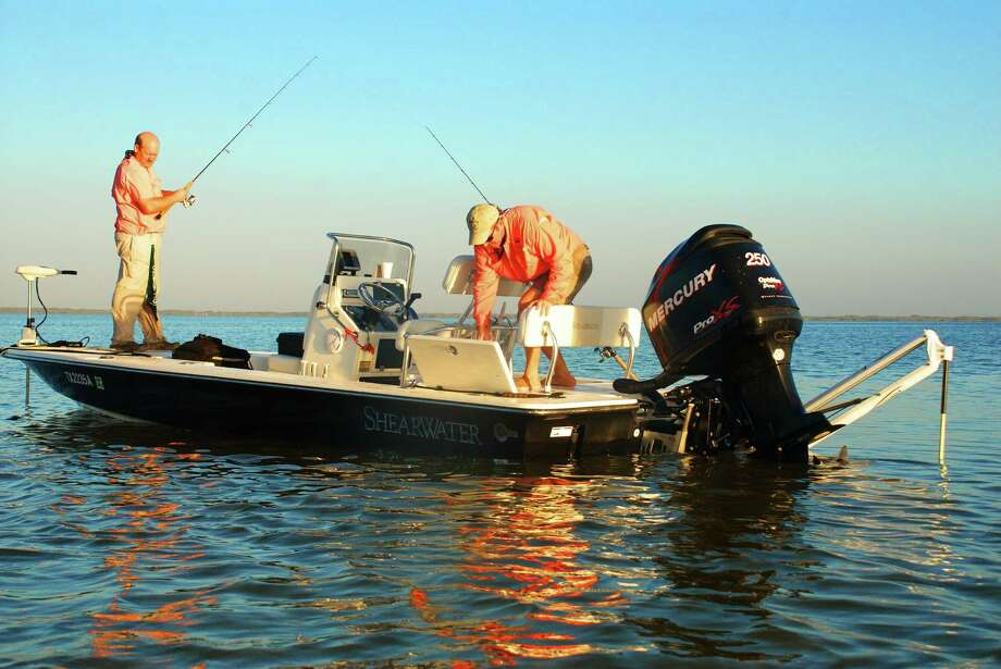 Bottom-grabbing devices like the Power Pole, visible behind the motor, enable boaters to push a button to allow them to employ shallow-water anchoring. Photo: Houston Chronicle