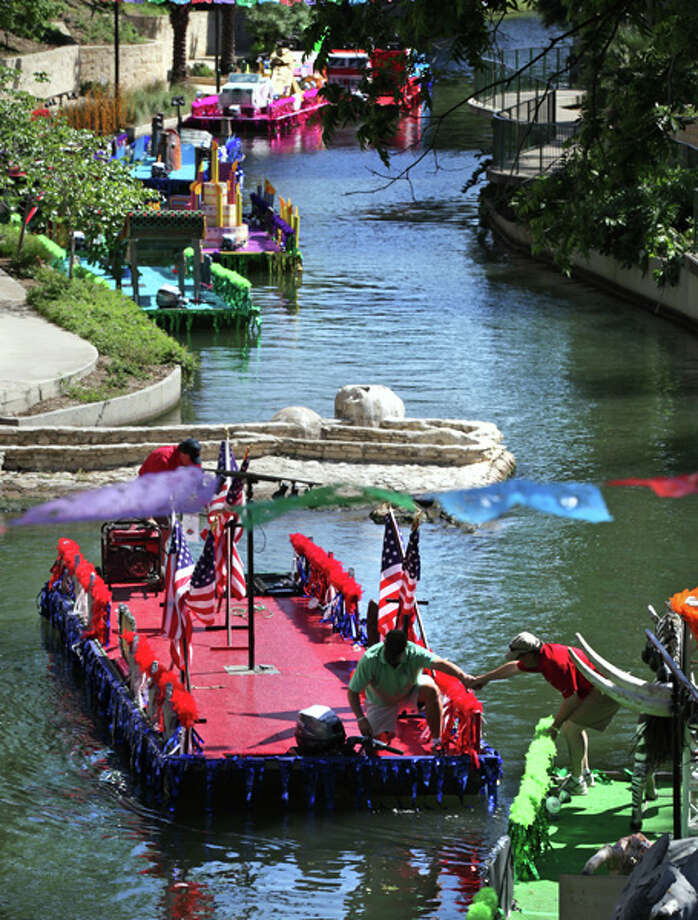 Members of the Texas Cavaliers work to line up the barges for tonight's Texas Cavalier's River Parade, on the San Antonio River under Lexington Avenue on April 23, 2012. Photo: BOB OWEN, Bob Owen / San Antonio Express-News / © 2012 San Antonio Express-News