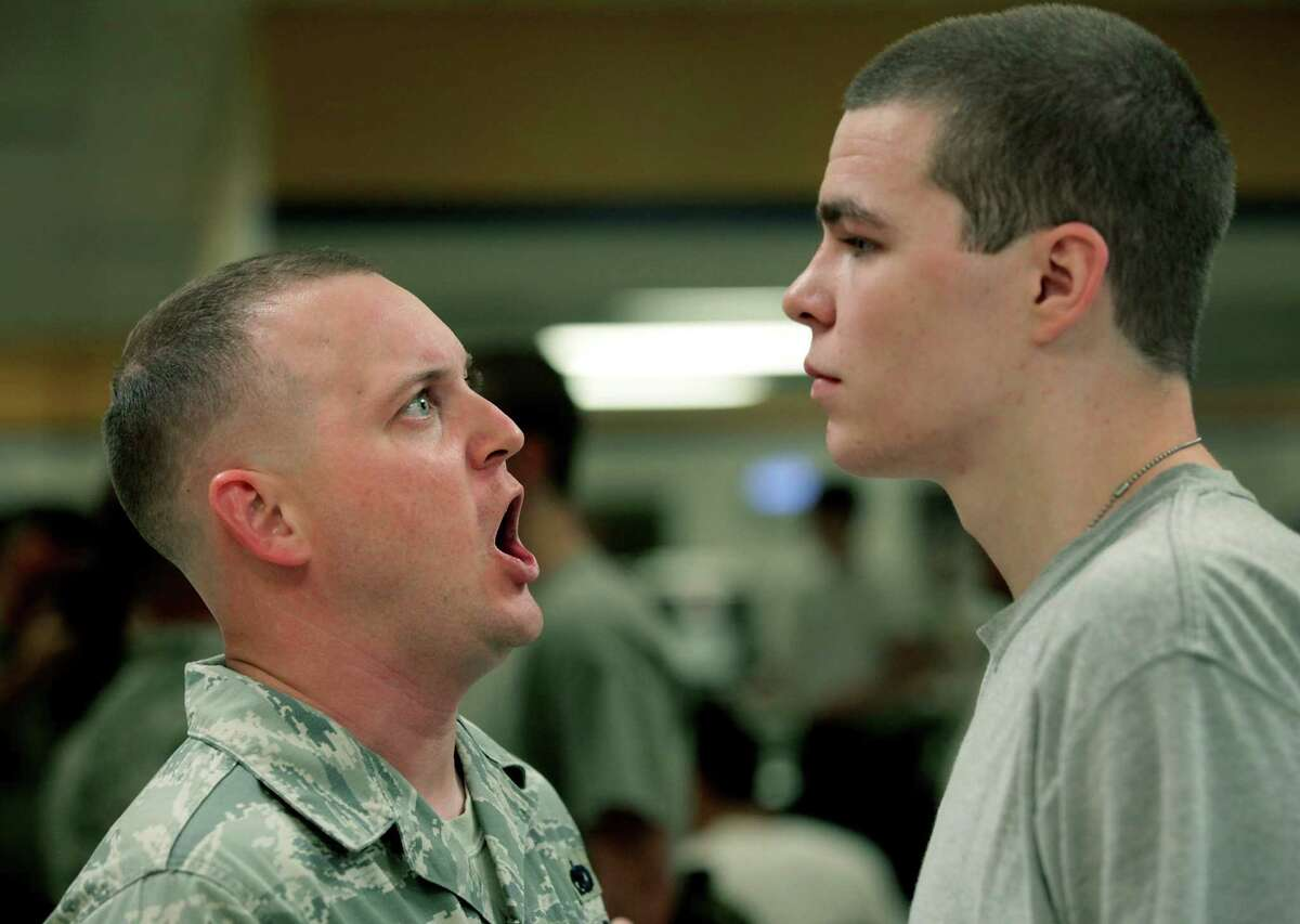 TSgt Christopher Sullivan, left, yells instructions at a trainee after eating in the mess hall. The first 72 hours of basic training at Lackland AFB is called Zero Week, when trainees learn to march and speak the Air Force way of life. Wednesday, April 18, 2012.