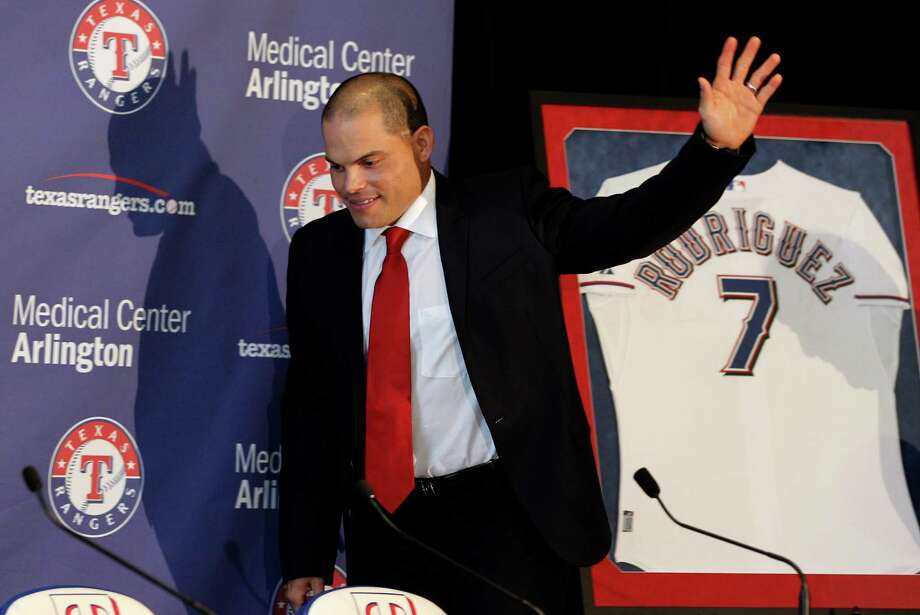 Former Texas Rangers Ivan Rodriguez waves as he arrives for a news conference announcing his retirement as a baseball player, Monday, April 23, 2012 in Arlington, Texas. (AP Photo/LM Otero) Photo: LMO Otero, Associated Press / AP