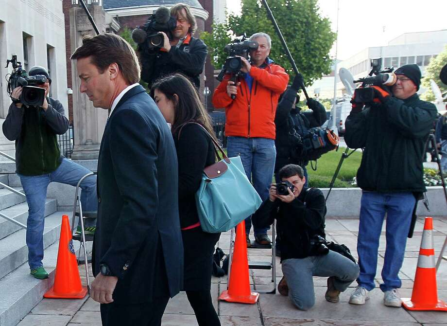 Former presidential hopeful John Edwards and daughter Cate Edwards Upham arrive at federal court in Greensboro, N.C., on Monday. Photo: Gerry Broome, Associated Press
