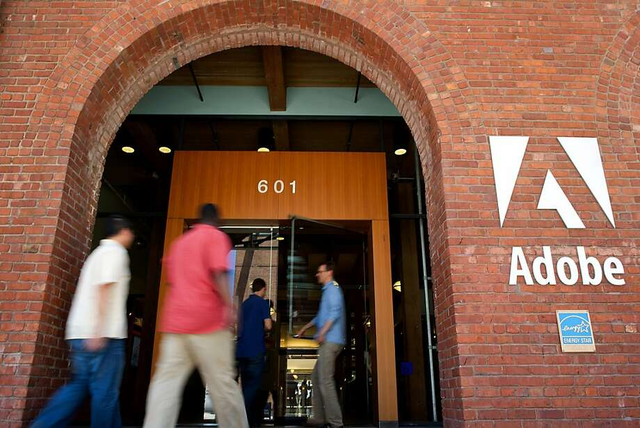 People enter the Adobe Systems Inc. office in San Francisco, California, U.S., on Tuesday, June 21, 2011. Adobe Systems Inc., the largest maker of graphic-design software, reported second-quarter sales that exceeded analysts' estimates, rebounding from adisruption in demand caused by the March earthquake in Japan. Photographer: David Paul Morris/Bloomberg Photo: David Paul Morris, Bloomberg News