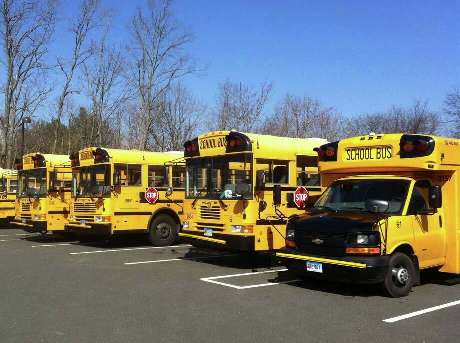 Board of Education members are exploring prospective new parking venues for the school district's bus fleet. Up to 12 buses are parked each day at an Imperial Avenue parking lot near the Westport Public Library. Photo: Paul Schott / Westport News