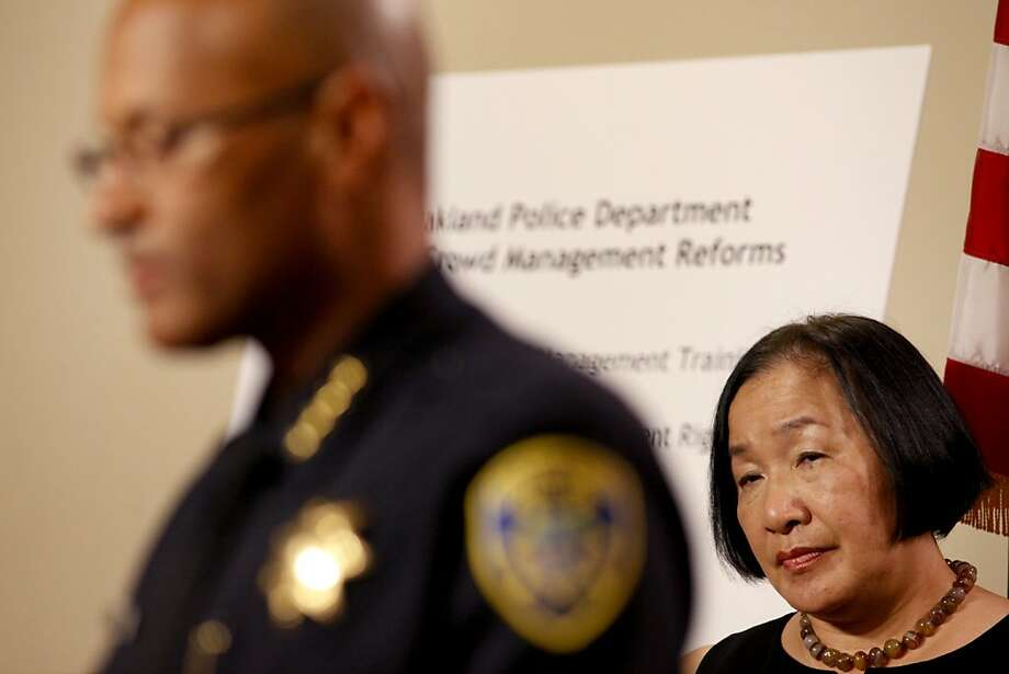 Oakland Police Chief Howard Jordan (left) and Mayor Jean Quan, seen at an April news conference, are under pressure to comply with court orders to reform the department. Photo: Lacy Atkins, The Chronicle