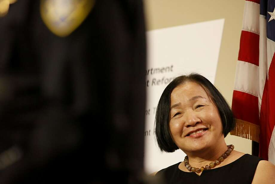 Mayor Jean Quan listens to Chief of Police Howard Jordan announce the police departments crowd management reform to help with the way officers interact with Occupy Oakland, Monday April 23, 2012, during a press conference at City Hall in Oakland, Calif. Photo: Lacy Atkins, The Chronicle
