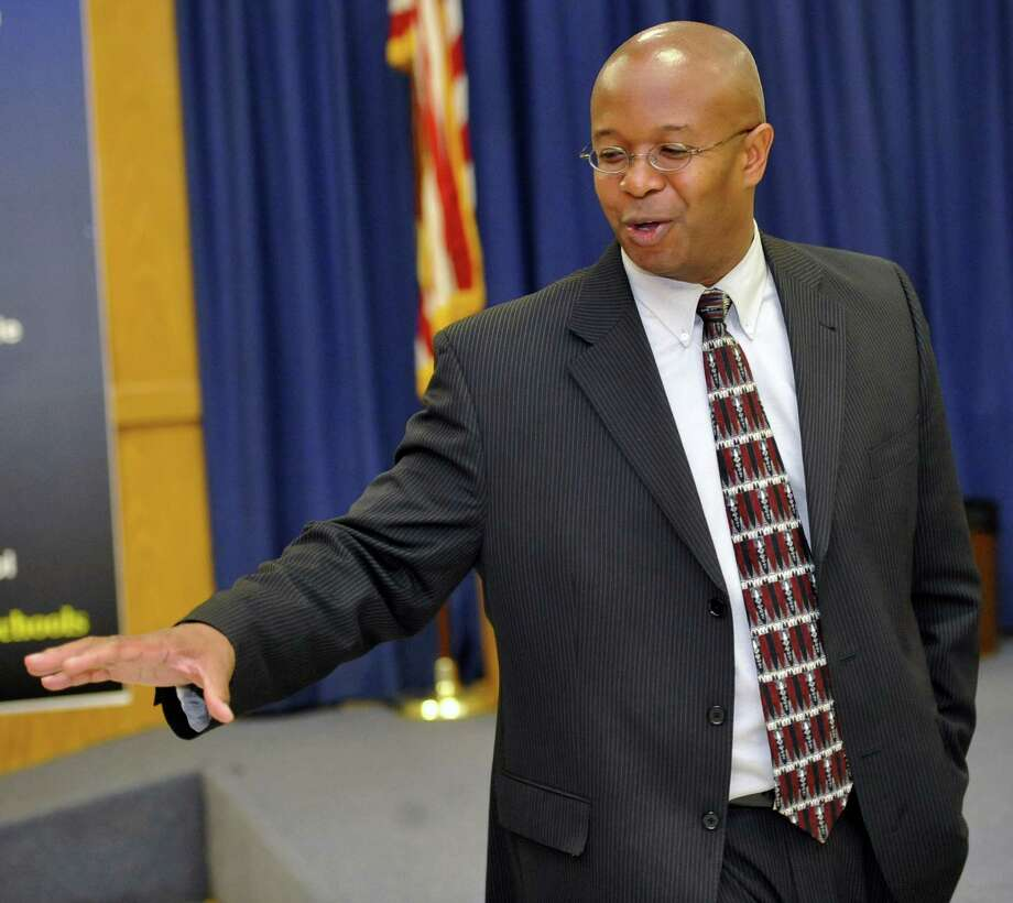 Assistant Superintendent Research/Evaluation Timothy Chargois greets the media as he enters the BISD Board Room Monday night. He and Deputy Superintendent Shirley Bonton  were the finalists before the board went into Executive Session. Beaumont ISD trustees met in a special meeting to name a lone finalist to replace retiring superintendent Carrol Thomas. Dave Ryan/The Enterprise Photo: Dave Ryan