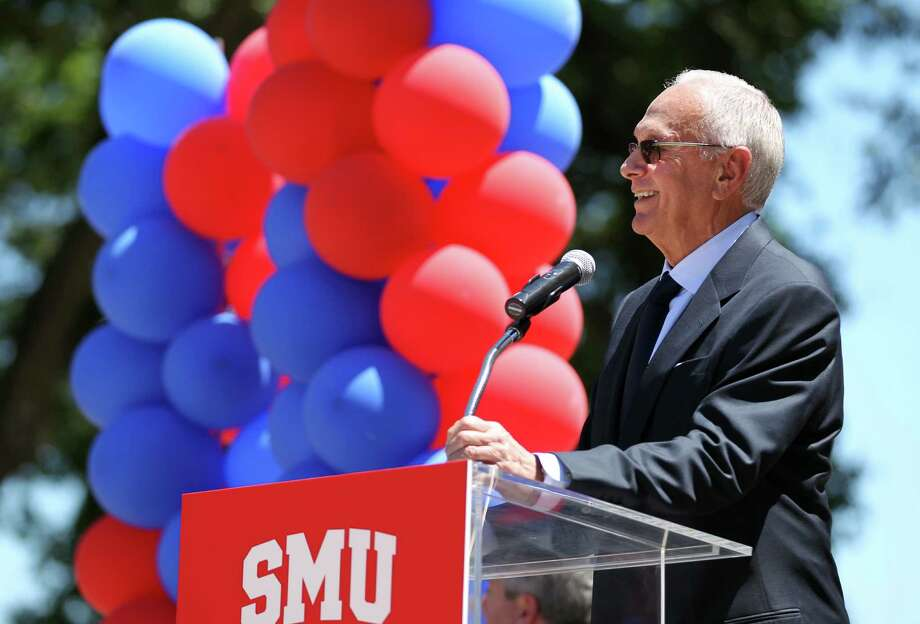 """Larry Brown speaks during his introduction as SMU men's basketball coach in front of Moody Coliseum in Dallas on Monday, April 23, 2012. Brown is taking his first college coaching job in nearly a quarter century. With trustees and more than 100 fans cheering and clapping, Brown said he was looking forward to coaching """"quality basketball with quality student-athletes."""" (AP Photo/The Dallas Morning News, Kye R. Lee) MAGS OUT  TV OUT  MANDATORY CREDIT Photo: AP"""