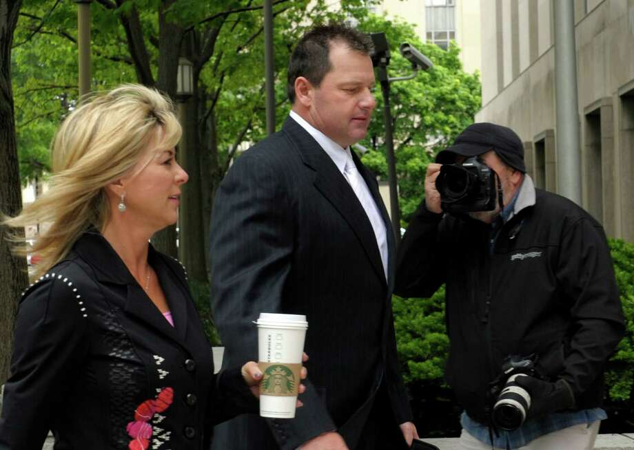 Retired major league pitcher Roger Clemens and his wife, Debra Lynn Godfrey, arrive at federal court in Washington, D.C., on Monday. Clemens is being tried on perjury charges. Photo: Susan Walsh, Associated Press